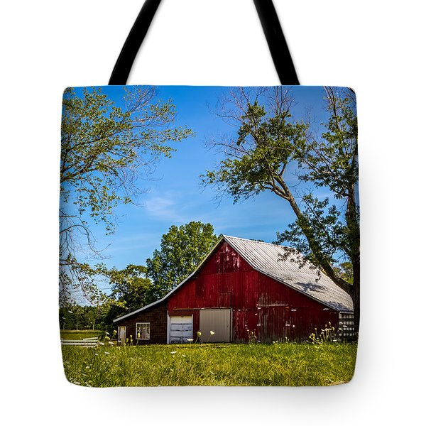 Tote Bag featuring the photograph Red Barn In The Trees by Ron Pate