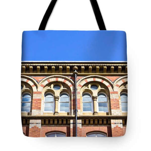 Red Brick Building  Tote Bag by Tom Gowanlock
