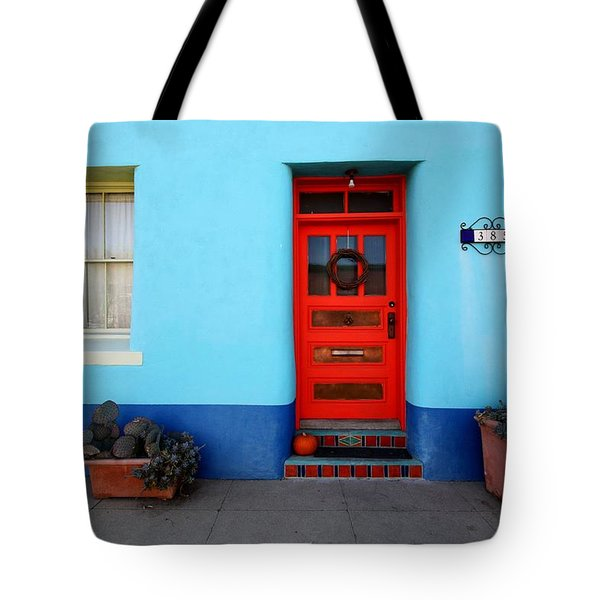 Red Door On Blue Wall Tote Bag by Joe Kozlowski