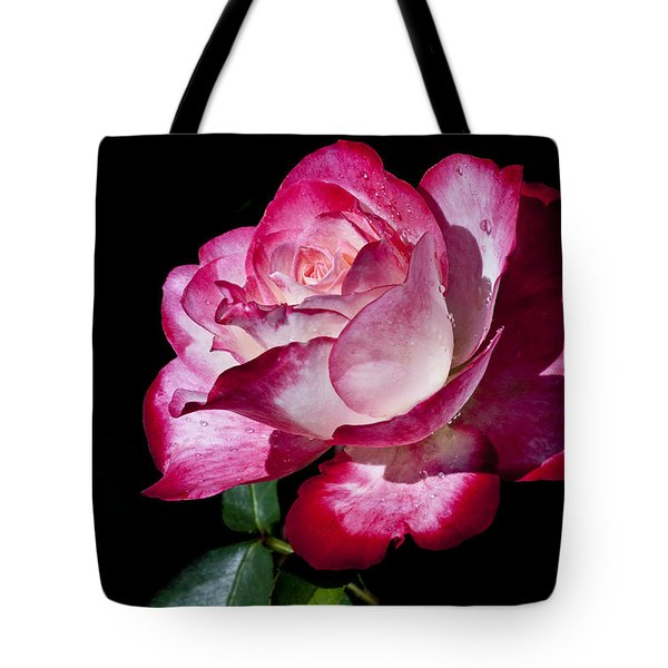 Tote Bag featuring the photograph Red Flame by Doug Norkum