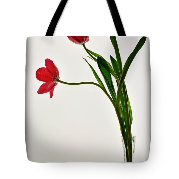 Red Flowers In Glass Vase Tote Bag