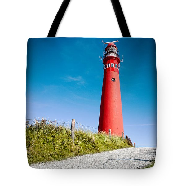 Red Lighthouse And Deep Blue Sky. Tote Bag
