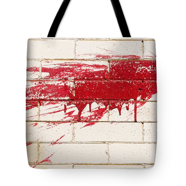 Red Splash On Brick Wall Tote Bag
