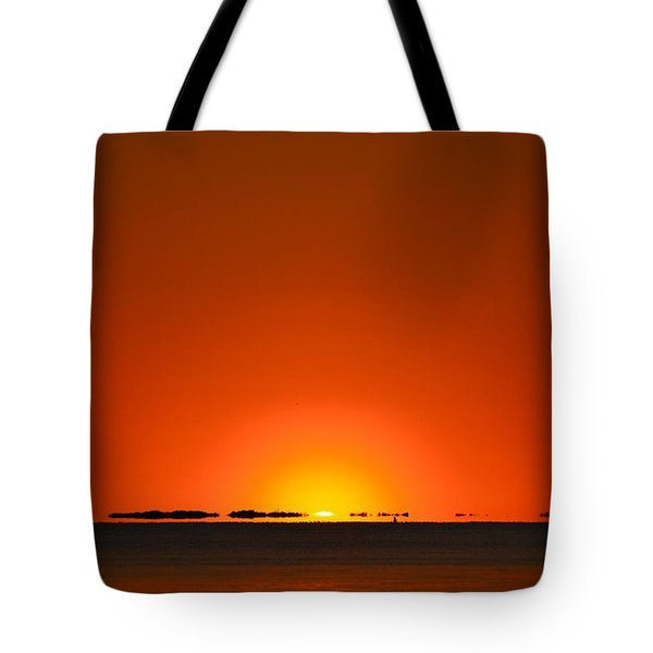 Tote Bag featuring the photograph Red Sunset With Superior Mirage On Santa Rosa Sound by Jeff at JSJ Photography