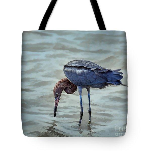 Reddish Egret Feeding In Shallow Water Tote Bag