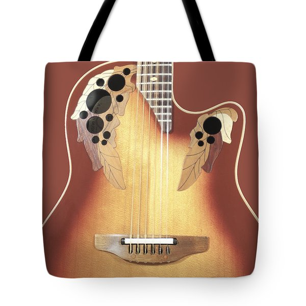 Tote Bag featuring the photograph Redish-brown Guitar On Redish-brown Background by Richard J Thompson