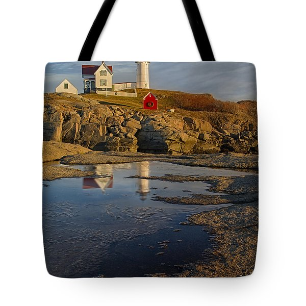 Reflecting On Nubble Lighthouse Tote Bag by Susan Candelario