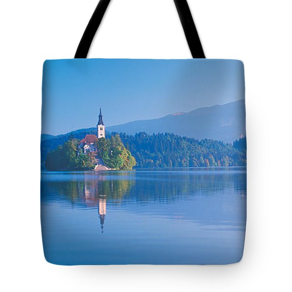 Reflection Of Mountains And Buildings Tote Bag
