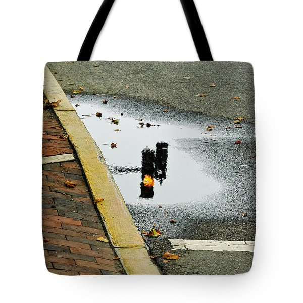 Tote Bag featuring the photograph Reflection Of Traffic Light In Street Puddle by Gary Slawsky