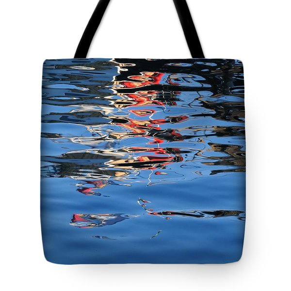 Tote Bag featuring the photograph Reflections In Red by Susie Rieple