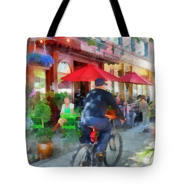 Riding Past The Cafe Tote Bag by Susan Savad