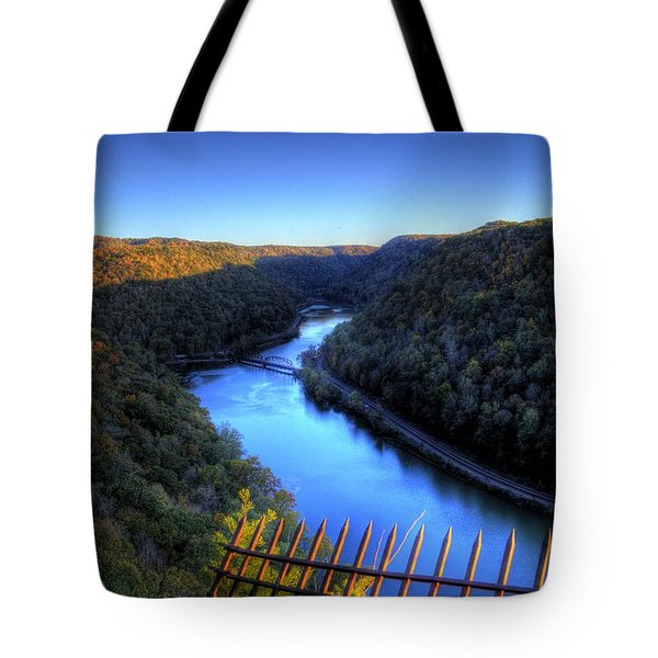 Tote Bag featuring the photograph River Through A Valley by Jonny D