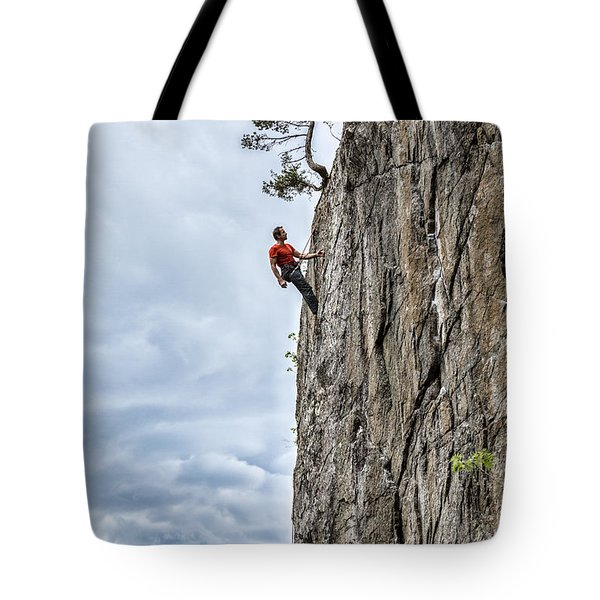 Tote Bag featuring the photograph Rock Climber by Carsten Reisinger