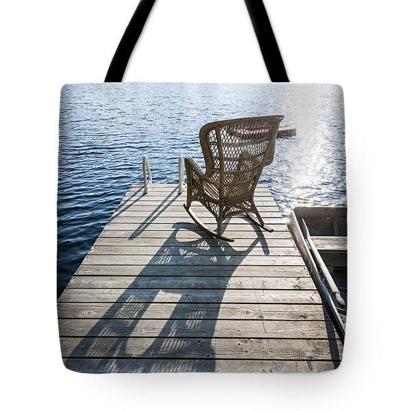 Rocking Chair On Dock Tote Bag by Elena Elisseeva