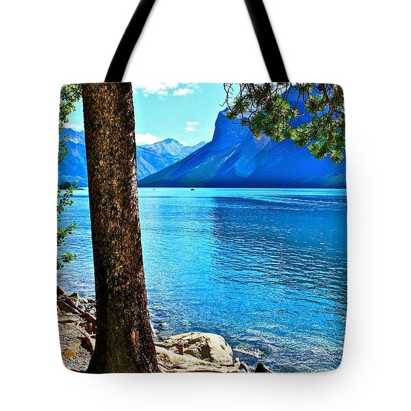 Tote Bag featuring the photograph Rooted In Lake Minnewanka by Linda Bianic