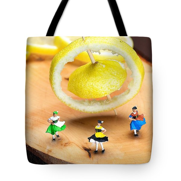 Tote Bag featuring the photograph Rotating Dancers And Lemon Gyroscope Food Physics by Paul Ge