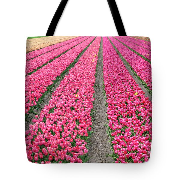 Rows Of Bright Pink Tulips In A Field Tote Bag