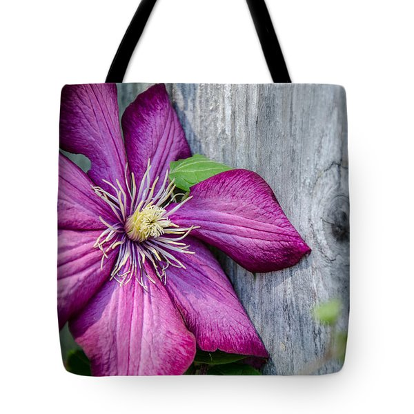 Tote Bag featuring the photograph Rustic Clematis by Susan  McMenamin