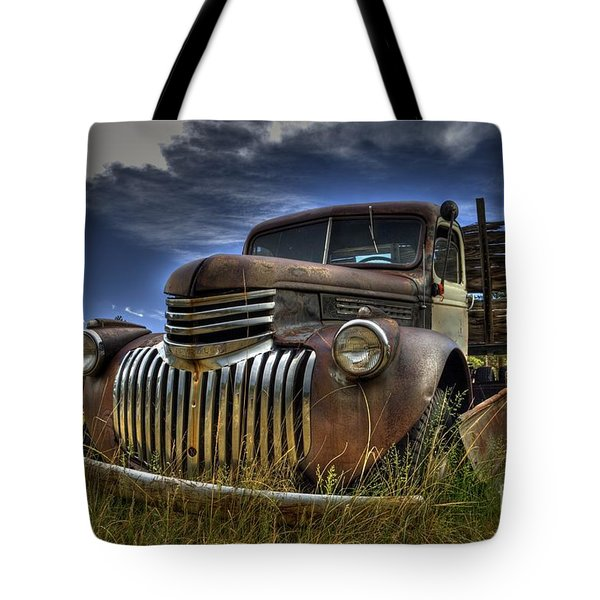 Tote Bag featuring the photograph Rusty Relic by Tony Baca