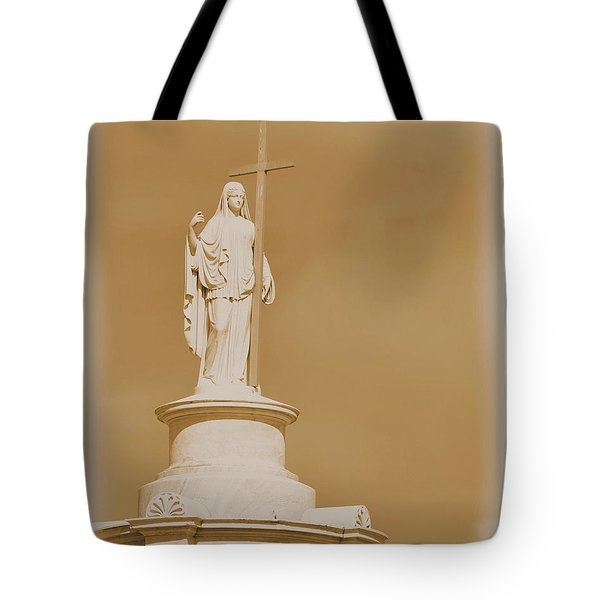 Tote Bag featuring the photograph Saint With A Cross by Nadalyn Larsen