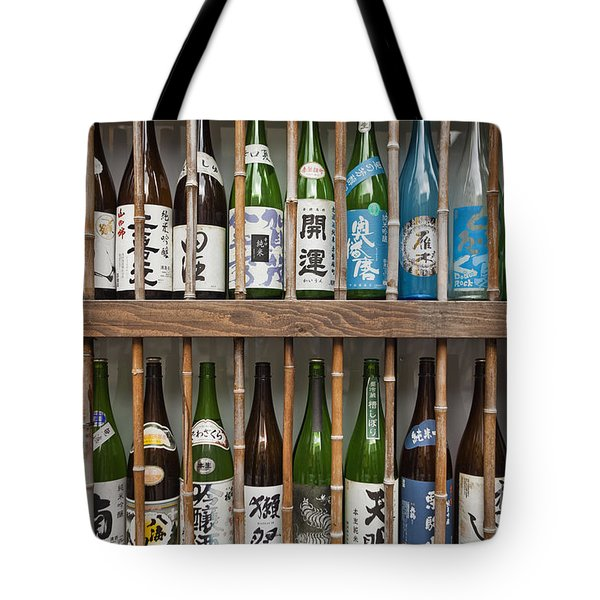 Tote Bag featuring the photograph Sake Bottles by Bryan Mullennix