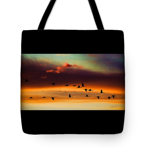 Sandhill Cranes Take The Sunset Flight Tote Bag by Bill Kesler