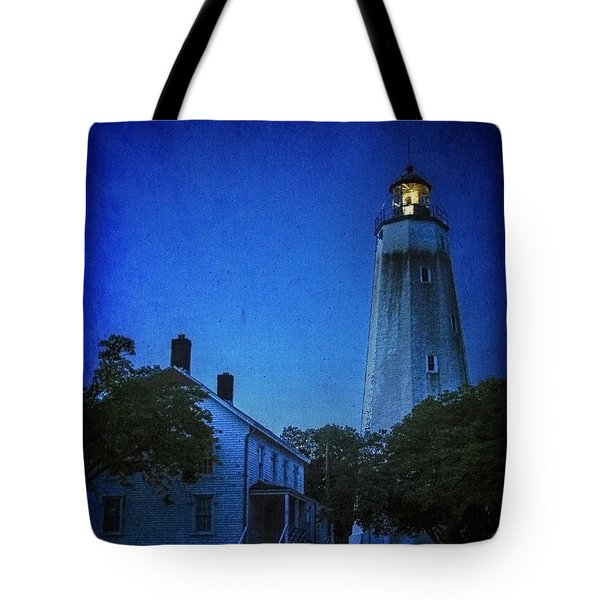 Tote Bag featuring the photograph Sandy Hook Lighthouse At Twilight by Debra Fedchin