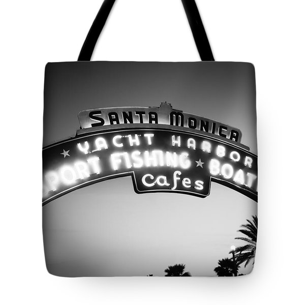 Santa Monica Pier Sign In Black And White Tote Bag by Paul Velgos