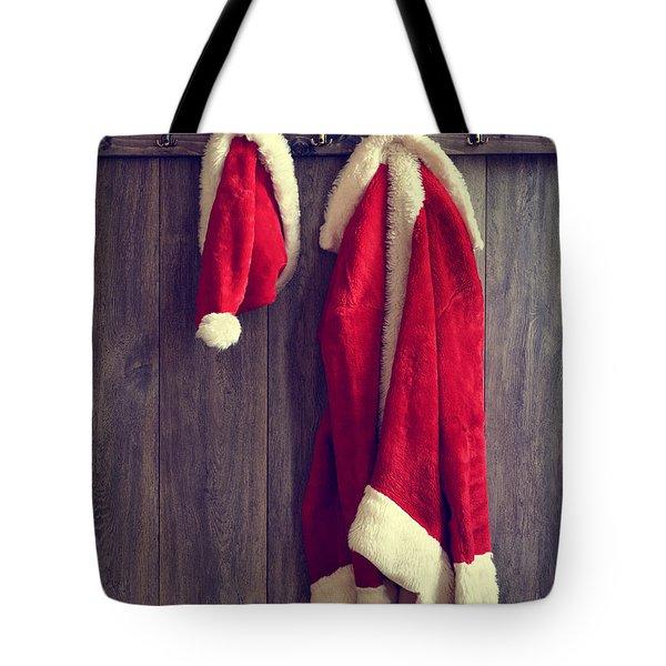 Santa's Hat And Coat Tote Bag by Amanda Elwell