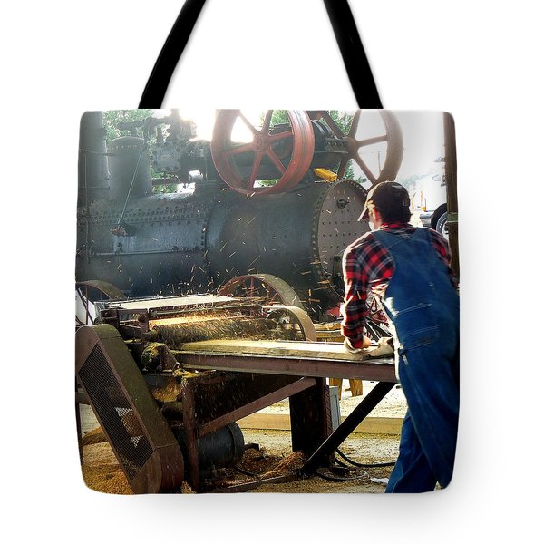 Tote Bag featuring the photograph Sawmill Planer In Action by Pete Trenholm