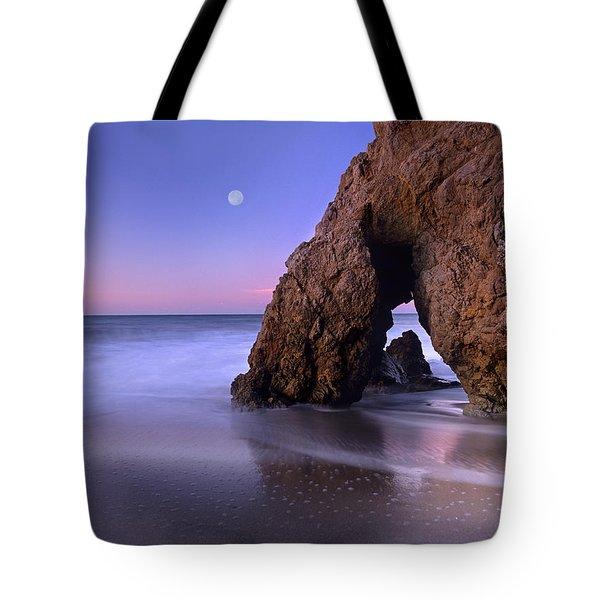 Sea Arch And Full Moon Over El Matador Tote Bag by Tim Fitzharris