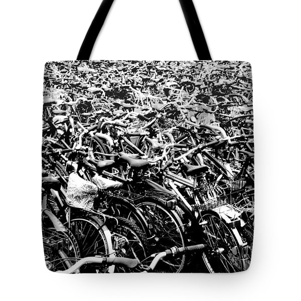 Tote Bag featuring the photograph Sea Of Bicycles 3 by Joey Agbayani