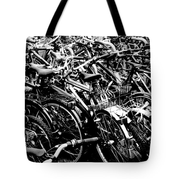 Tote Bag featuring the photograph Sea Of Bicycles 2 by Joey Agbayani