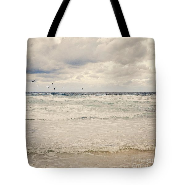 Seagulls Take Flight Over The Sea Tote Bag by Lyn Randle