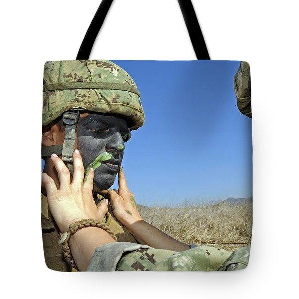 Seaman Has His Face Painted To Help Tote Bag by Stocktrek Images