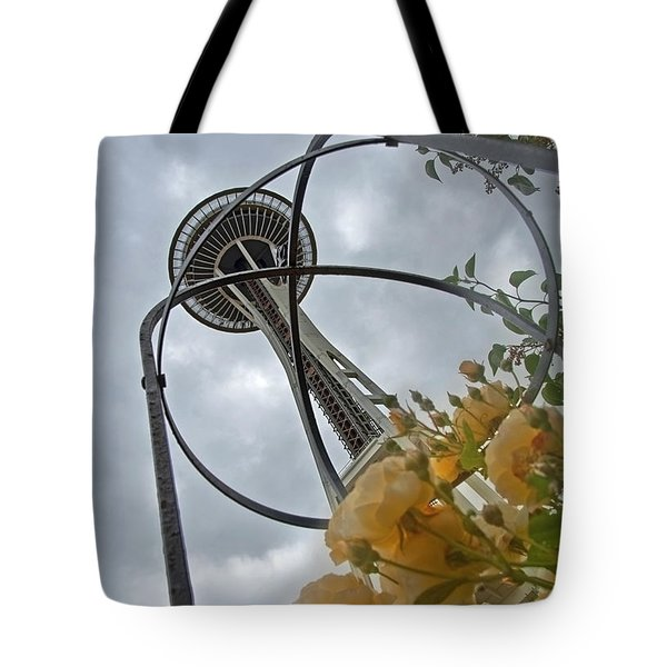 Tote Bag featuring the photograph Seattle Spaceneedle With Watercolor Effect Yellow Roses by Valerie Garner