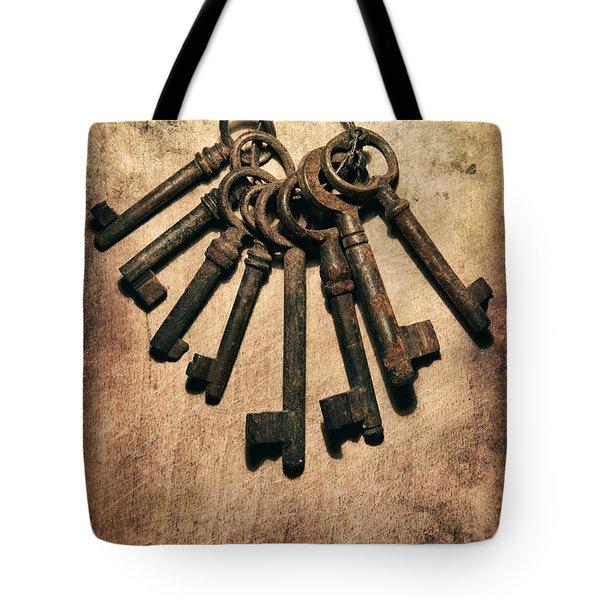 Set Of Old Rusty Keys On The Metal Surface Tote Bag by Jaroslaw Blaminsky