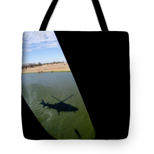 Shadow Rescue  Tote Bag by Paul Job