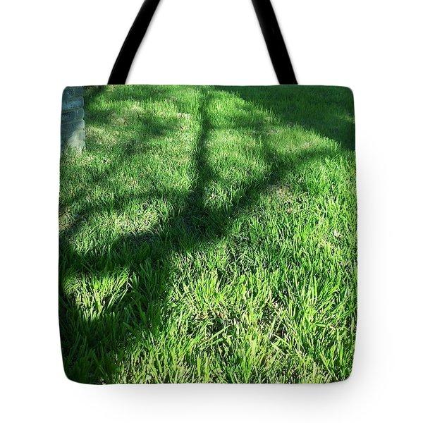 Shadows Reaching Tote Bag
