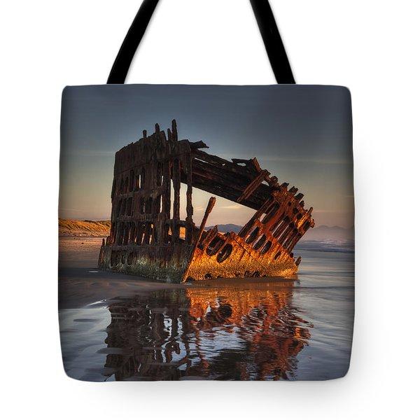 Shipwreck At Sunset Tote Bag by Mark Kiver