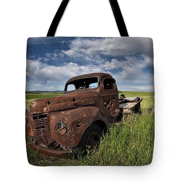 Shot Up Tote Bag by Leland D Howard