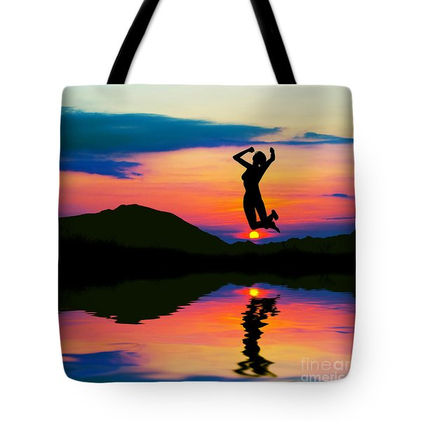 Silhouette Of Happy Woman Jumping At Sunset Tote Bag by Michal Bednarek
