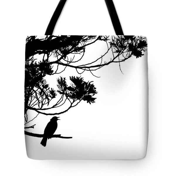 Silhouette Of Singing Common Blackbird In A Tree Tote Bag by Stephan Pietzko