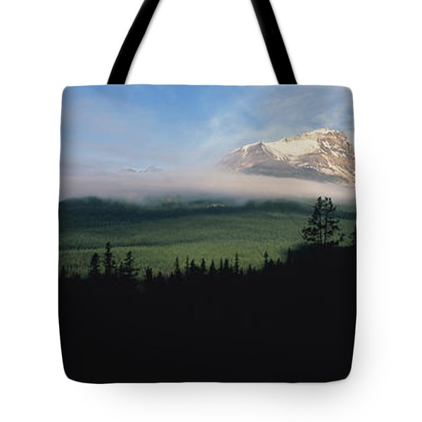 Silhouette Of Trees With A Mountain Tote Bag