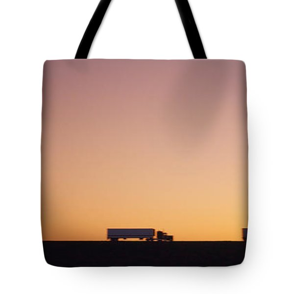 Silhouette Of Two Trucks Moving Tote Bag