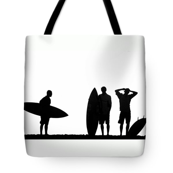 Silhouetted Surfers Tote Bag by Sean Davey
