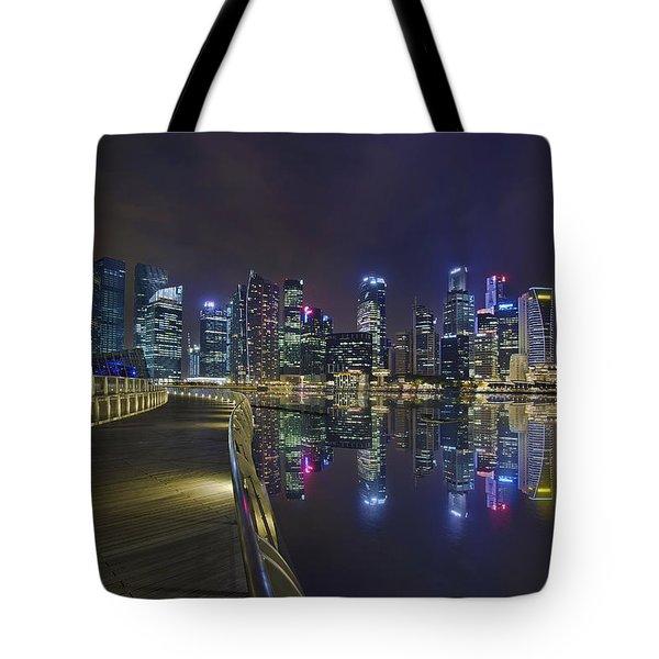 Singapore City Skyline Along Marina Bay Boardwalk At Night Tote Bag by David Gn