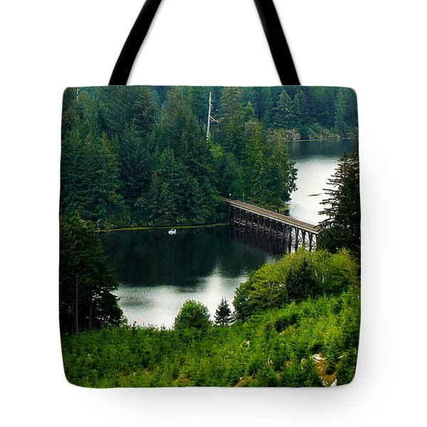 Tote Bag featuring the photograph Single Boat by Katie Wing Vigil