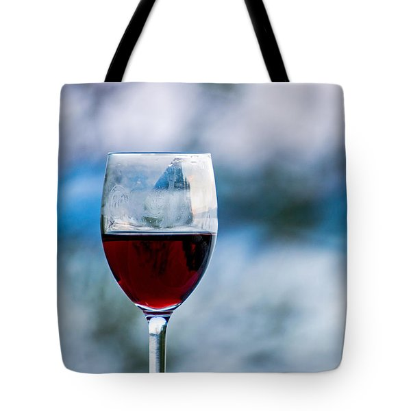 Single Glass Of Red Wine On Blue And White Background Tote Bag by Photographic Arts And Design Studio