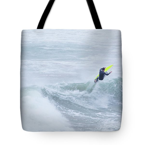 Single Surfer Riding A Wave In Autumn Tote Bag